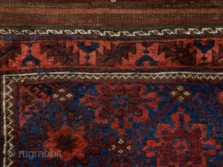 """Superbly executed Northeast Persian Belouch Rug from the turn of the 19th century with lustrous blues, an animated main field, and a crisply articulated design. (3' x 4'8"""")"""