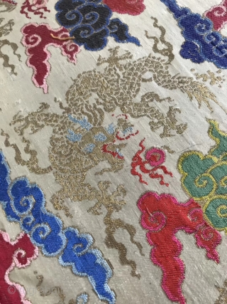 A Qing Dynasty embroidery brocade from China in the early 19th century  On the white silk and satin, the silk is weaved with colorful silk thread, and the golden dragon is weaved with  ...