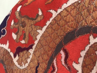 An official tonic of embroidery troupe dragon in Qing Dynasty from China in the late 18th century  A golden dragon with five claws was woven with gold thread on a piece of red  ...