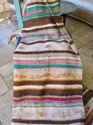 A ca. 1970 Moroccan hanbel with a field striped in earth tones and pops of color in turquoise, tangerine and more. Minimal pattern of pile construction.  Weft is wool - natural cream  ...