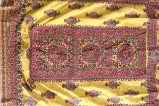 A wonderful example of Mochi embroidery from Kutch, Gujarat. This yellow satin silk wedding coat is beautifully decorated in chain stitch all over to depict parrots and floral motifs. The front pocket  ...