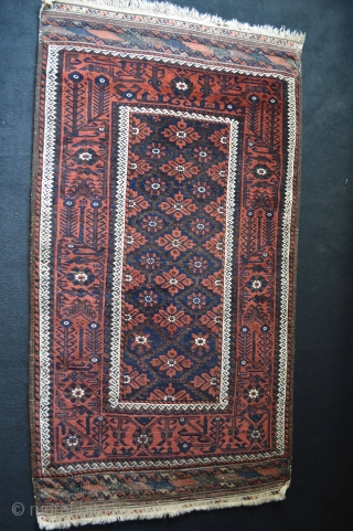Beautiful mint Condition Baluch is made by one of the Tribes in Khorasan during 1890s. Exceptional border Compostion and very nice flowers patern.Coroded Silk highlights on kilim border.