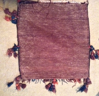 """For sale is a 1920-30, Afganistan belouch bag with tassels and kilim backing, 1'8""""x 2'2"""" in very good pile and condition. Braided selvedge, vegetable colors."""