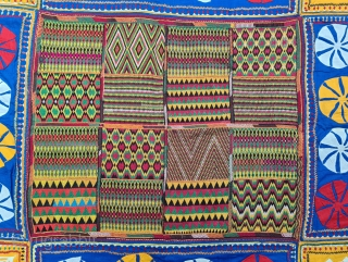 Ceremonial Banjara Baby Jolna From Madhya Pradesh. India. Known As Jolna.The Centre is worked in counted bricks stich, Framed with embroidery and applique work.