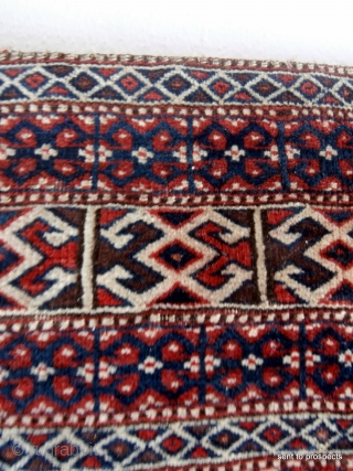 YAMOUT TURKOMAN SADDLE RUG. A finely woven and very intricate piece which originates from the small Yamout sub groups of Jaffarbi or Goklen in the southern Turkmenistan/northern Persia region. They are called  ...