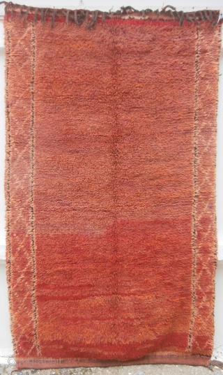 MOROCCAN BERBER MIDDLE ATLAS RUG which is old, supple and soft and has a knotted pile of many shades of madder ranging from tan through to reds and hints of purple. It  ...