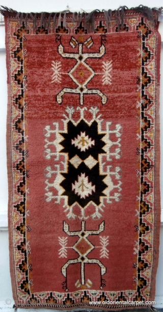 MOROCCAN BERBER RUG originating from the High Atlas mountains and the Ait Ouaouzguite Berbers. This region lies south of Marrakesh. At each end of the field there is a design which translates  ...