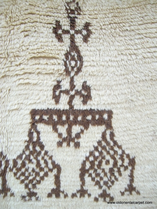 MOROCCAN MIDDLE ATLAS BERBER RUG. A rare and fascinating rug from the Berbers of Beni Ourain in the Middle Atlas mountains. It is soft and supple with lustrous wools with undyed brown  ...