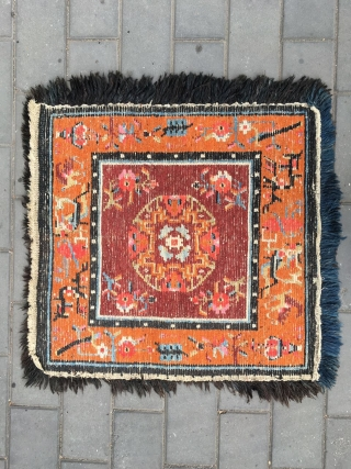 Out of the trunk of a monastery comes this perfect Tibetan square mat, a high rank lama individual seat in extraordinary mint condition, unused, no repairs, excellent wool with typical monastic colors,  ...