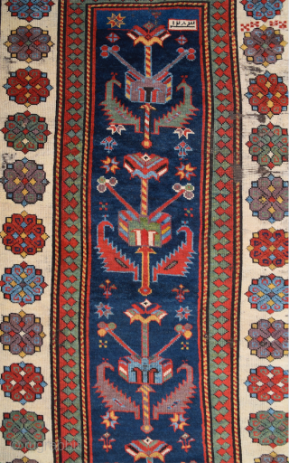 Rare and early example The first-rate carpet with a deep blue met hane field seven shrubs, each interspersed with a row of three rosettes, combine to form an ascending rare design. 