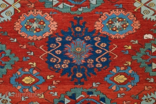 Caucasian 1860s Zeikhur sumakh Complex small-pattern repeat of octagons, eight-pointed stars, palmettes, rosettes and many abstract animals is arranged symmetrically around the vertical axis of the red-ground field. The design reminiscent of  ...