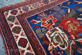 Brilliant Afshar rug, with Gol Farang design, late 19thC. Size 143 x 163cm/ 57 x 65 inches.Colors are superb, with a stunning electric blue field. The design and borders are masterly executed.  ...