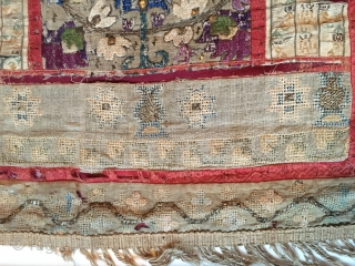 A fine silk on linen Greek Island embroidery, with ottoman influences, several sections pieced together, some gold(-ish) and silver(-ish) threads in the middle floral section. Looks like a prayer niche. The 2  ...
