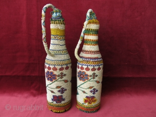 A pair of antique micro glass beaded bottle jackets. Presumably made by Greeks in Western Turkey in late 19th century. Despite their age, they are in great condition. Even the corks are  ...