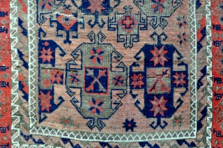 Baluch rug with Gurbaghe Guls and rare border, all natural colors including a nice lavender and purple, 19th c. piece in good original condition without repairs. Side selvages in good original condition and  ...