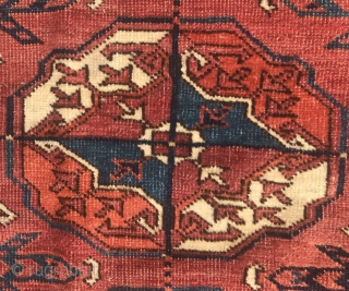 """Turkmen Tekke Main Carpet 6'1.5"""" x 7'6.5"""" with good age, glossy wool, with pre-waterbug stars in the border, and layout, deeply saturated colors that come from a small group of weavings referred  ..."""