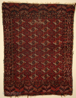 """TEKKE small rug (wedding?). 41"""" x 53"""" from the 4th quarter of the 19th Century.  Missing a bit on both sides. Interesting primary side borders.One area (shown) that needs re-knotting. Glossy,  ..."""