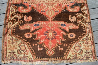 Interesting Kurdish / likely Malayer area rug.  Has good age and a great look. If you look closely you will notice the different tonings between dark brown and black from one  ...