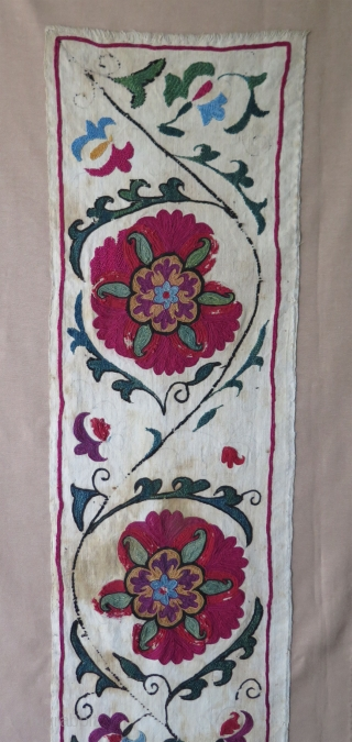"""Antique Uzbekistan Suzani fragment from late 19th century. Silk embroidery on cotton.  Professionally mounted. Size: 9.8"""" x 50.6"""" - 25 cm x 129 cm."""