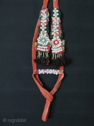 Anatolian Turkmen Pack animal band from Taurus mountains, hand braided and natural dyed strap decorated with cowry shells, ivory buttons, glass beads, wool fabrics and wool tassels on both ends. Circa 1900-1920s.  ...
