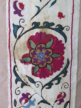 "Antique Suzani fragment. Circa 19th Century. Mounted on cotton fabric. Size: 9.8"" x 50.6""  25 cm x 129 cm."