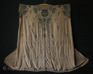 Ottoman silk and metallic embroidered dress.  Circa late 19th Century. It has some small damages and one larger one about 5″ – 12 cm and some stains. I tried to show  ...