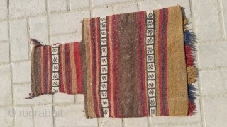 This curiously shaped tribal bag is NAMAKDAN.A bag used for storing rock salt. Size 65×42 cm.For more info contact on my email.Nabizadah_carpets@yahoo.com