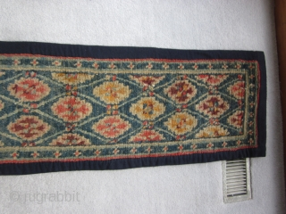 "Tibetan. This is a type of runner made in Tibet for use in Hindu feeding ceremonies in Nepal. It is a 20th C piece, `1'5"" by 9'9"" See Kuloy, ""Tibetan Rugs"" pps.226-7  ..."