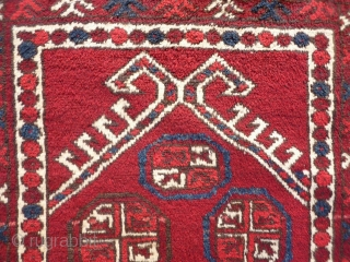 "A soft, glossy and shinny prayer rug woven by ethic Uzbeks in Afghanistan. The 11 güls in the field are framed by a hooked Mihrab. The little ""flowers"" in the two white  ..."