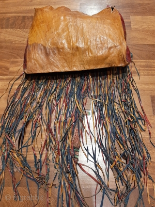 """Tuareg leather womans travel bag (""""aghrig""""), with hand worked and dyed leather, probably goat skin. Intricate leather work with check pattern cut into dyed skin. The green dyed leather colour is considered  ..."""
