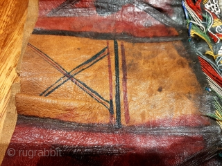 "Tuareg leather womans travel bag (""aghrig""), with hand worked and dyed leather, probably goat skin. Intricate leather work with check pattern cut into dyed skin. The green dyed leather colour is considered  ..."