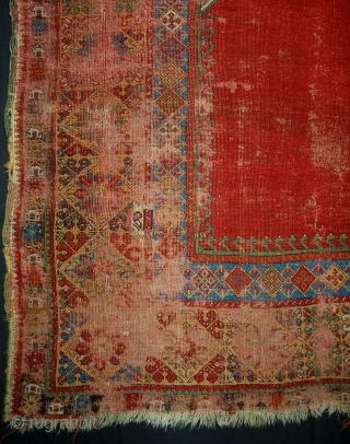 Early Mujur prayer rug. Circa 1800. Evident wear reflected in the price. Superb colours.