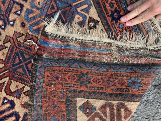 Lovely camel hair baluch rug. 220x125cm. 19th century. One small low area (see photo) otherwise in good in touched condition.