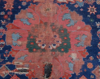 Rare and early north west persian kurdish carpet. Early 19th century with huge blossoms and medallions. Aprox 380 x 150 cm. Wear and holes and in need of a bath.