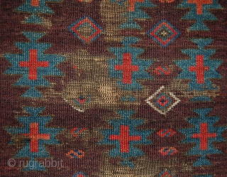 Early and dramatic east anatolian rug fragment. Super saturated purple ground colour with a design based on a kelim design.  Early 19th.c. or earlier.  97 x 122cm.