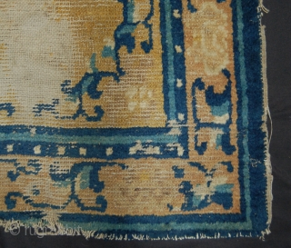 Small late 18th/early 19th century ning shia chinese rug. Worn with glue to the back. 125 x 68cm.