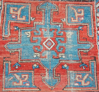 Perhaps a sha shavan  long rug. Worn, interesting and cheap..252 x 89cm. 19th.c. and all good colours.