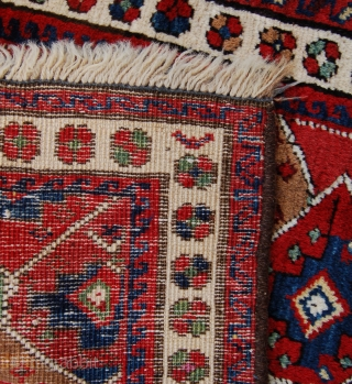 Piled north west persian bagface. Shashavan tribes. 58 x 52cm liberal use of camel hair. Spots of fuschine date it to corca 1880-1910. Cotton wefts and woollen warps. Full pile but over  ...