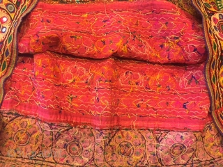 kutchi rabari child skirt hand embroided on satin silk from makhana village in kutch region gujarat the skirt is having beautiful hand embroided design of peacocks and flowers with beautiful base of  ...