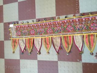 Rabari Mochi hand embroidered   long Toran  from bhujodi village Kutch region Gujarat with very fine work with vegetables dyes the size of the Toran is 112 inch X 18  ...