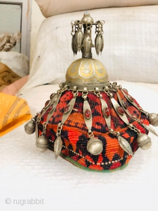 Vintage child's hat from Turkmenistan, Central Asia circa 1925 adorned with low grade silver ornaments studded with glass (resembling agate). The hat is in good condition without any damages or holes and  ...