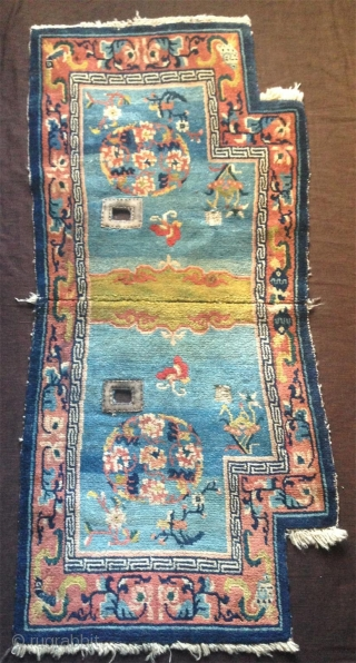 late 19th century tibetan saddle rug with superb all natural colors and fine wool.very nice abrashed light blue field and wonderful light green center..very good condition with super fine wool.