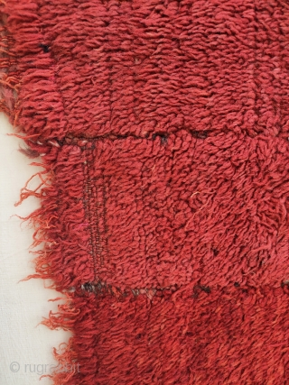 -master red- 19th c. warp-faced back long pile weaving on a tsukdruk loom. originaly a tibetan monk cloak. made of 16 narrow strips, fantastic red most probably from madder roots. best of type, very  ...