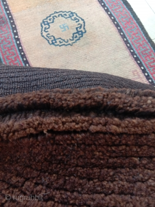 for those who really appreciate tibetan weaving culture...a truly nomadic saddle top , thick brown undyed abrashed pile with yak wool warps..complete and in good condition, early 20th c.