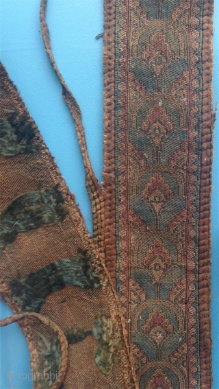 an extremly rare 7-8th c. central asian samite band with pearl border. the weave is much thicker than the common average for such things. over 100cm long and in good condition.