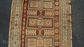 """Caucasian Kazak (exact provenance unknown to me, opinions invited). Earlier 20th century, 6' 4"""" X 3' 6"""", uncommon earth tone colors and pleasing design. No significant oxidization, scattered small holes, otherwise even  ..."""