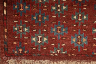 "Yomud ""Dyrnak"" main carpet, 310x170 cm, 19th cent., fantastic colors, different blues , greens, yellows.... unusual elem, opened, bold and graphic drawing, well balanced, spacious field, very fine weave, some unfolded part  ..."