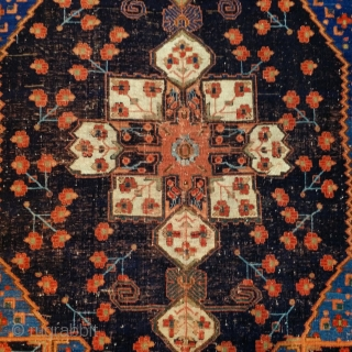 Afshar tribal weavers were inspired both by luxurious silk and woolen textiles as well as by formal city carpets from the urban weaving centers of Persia. This small rug has a medallion  ...