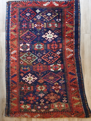 Kurdish rug of unknown origin. I would be happy to hear views. It has some obvious Sauj Bulagh design elements but otherwise is not typical. A beautiful wonky tribal piece with heavy  ...