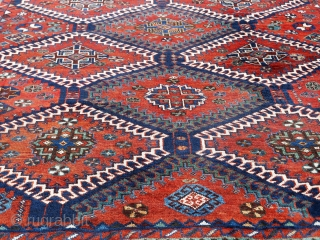 Early 1900s or older Persian Lori rug in the classic hooked-diamond all-over design All organic dyes. 